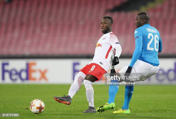 Player of SSC Napoli Kalidou Koulibaly vies with RB Leipzig player Naby Keita during UEFA Europa League Round of 32 match between Napoli and RB...