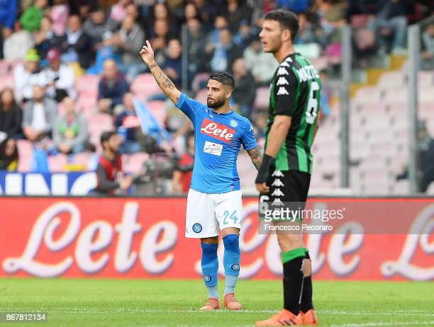Player of SSC Napoli Lorenzo Insigne celebrates after scoring the 21 goal beside the disappointment of Luca Mazzitelli player of US Sassuolo during...