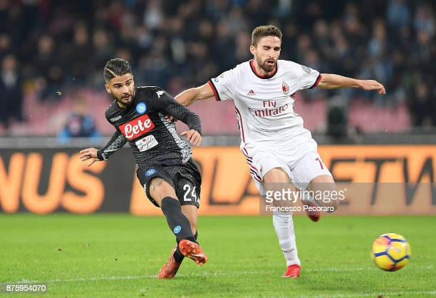 Player of SSC Napoli Lorenzo Insigne vies with AC Milan player Fabio Borini during the Serie A match between SSC Napoli and AC Milan at Stadio San...