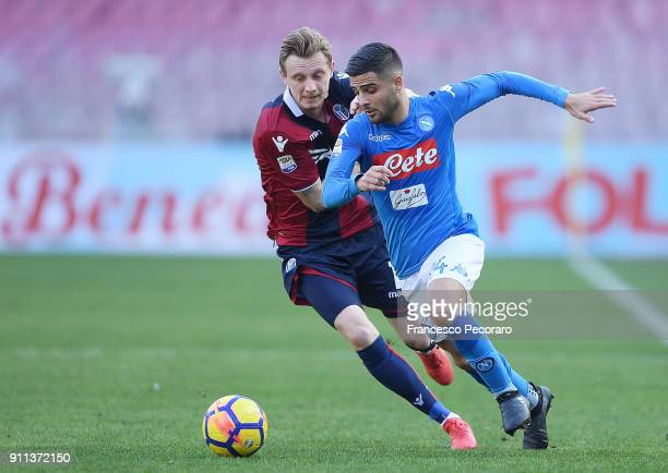 Player of SSC Napoli Lorenzo Insigne vies with Bologna FC player Ladislav Krejci during the serie A match between SSC Napoli and Bologna FC at Stadio...