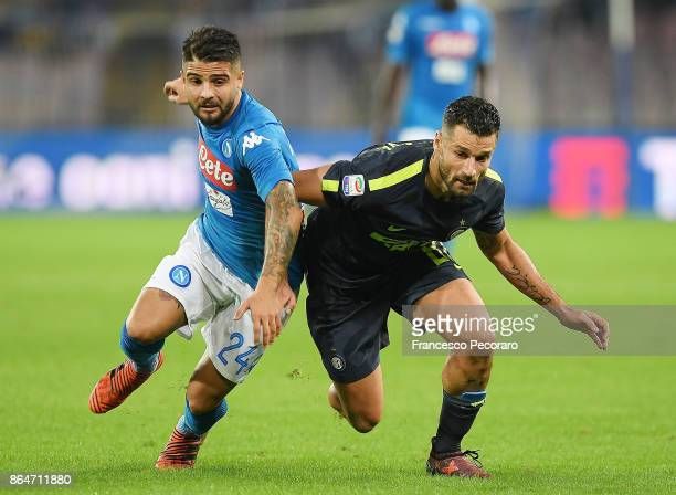Player of SSC Napoli Lorenzo Insigne vies with FC Internazionale player Antonio Candreva during the Serie A match between SSC Napoli and FC...