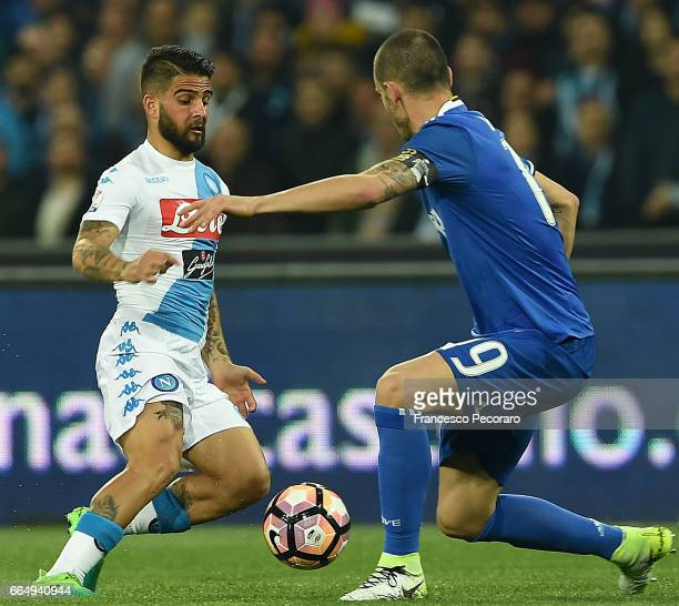 Player of SSC Napoli Lorenzo Insigne vies with Juventus FC player Leonardo Bonucci during the TIM Cup match between SSC Napoli and Juventus FC at...