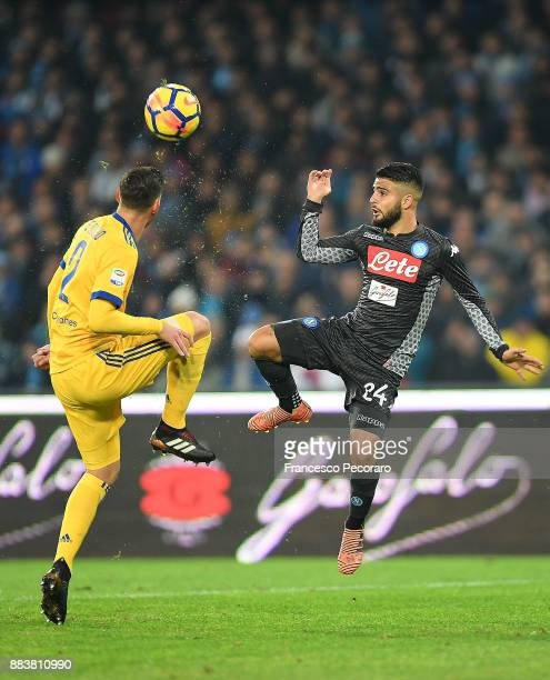 Player of SSC Napoli Lorenzo Insigne vies with Juventus player Mattia De Sciglio during the Serie A match between SSC Napoli and Juventus at Stadio...