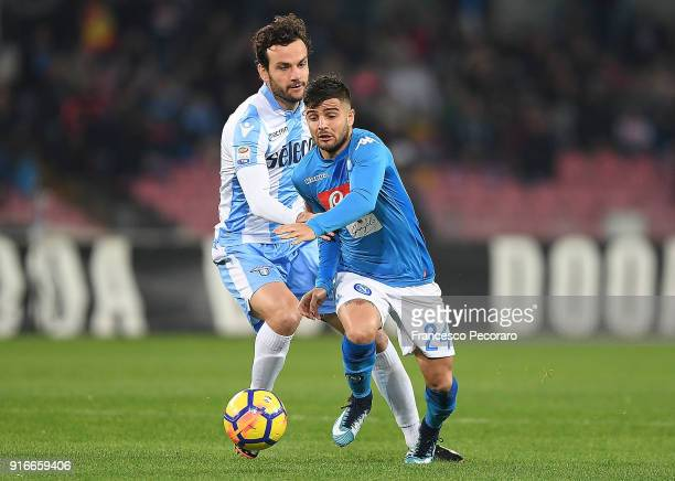 Player of SSC Napoli Lorenzo Insigne vies with SS Lazio player Marco Parolo during the serie A match between SSC Napoli and SS Lazio at Stadio San...