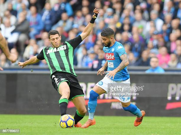 Player of SSC Napoli Lorenzo Insigne vies with US Sassuolo player Luca Mazzitelli during the Serie A match between SSC Napoli and US Sassuolo at...