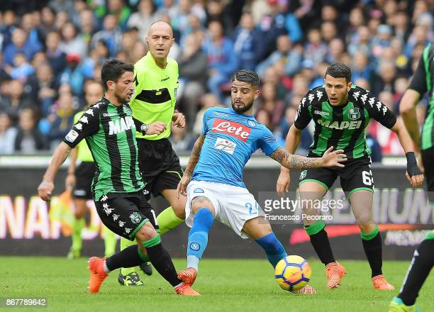 Player of SSC Napoli Lorenzo Insigne vies with US Sassuolo player Stefano Sensi during the Serie A match between SSC Napoli and US Sassuolo at Stadio...