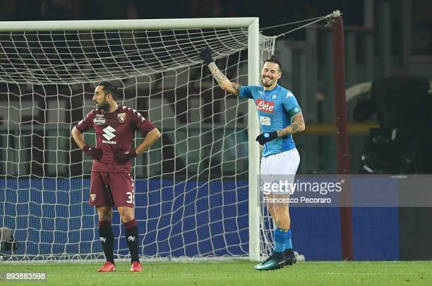Player of SSC Napoli Marek Hamsik celebrates after scoring the 03 goal beside the disappointment of Cristian Molinaro player of Torino FC during the...