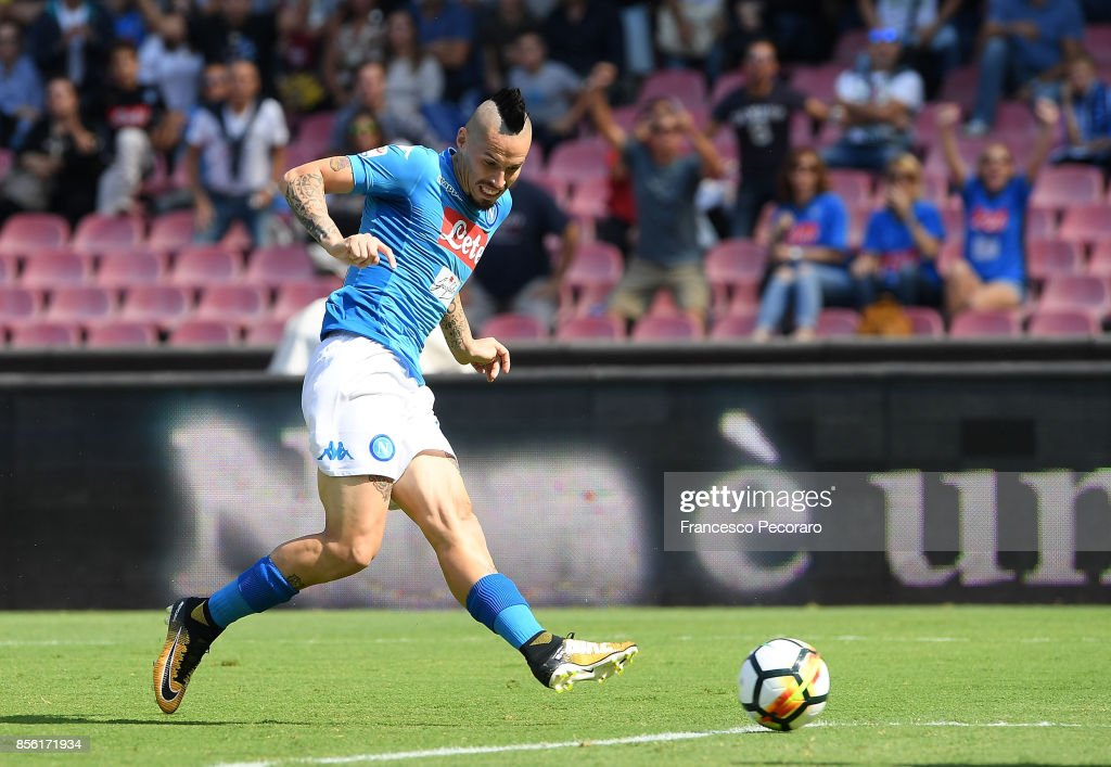 Player of SSC Napoli Marek Hamsik scores the 1-0 goal during the Serie A match between SSC Napoli and Cagliari Calcio at Stadio San Paolo on October 1, 2017 in Naples, Italy.