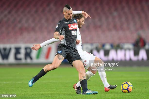Player of SSC Napoli Marek Hamsik vies with AC Milan player Manuel Locatelli during the Serie A match between SSC Napoli and AC Milan at Stadio San...