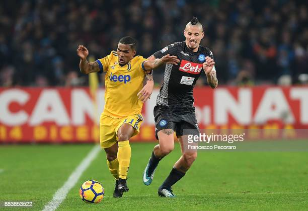 Player of SSC Napoli Marek Hamsik vies with Juventus player Douglas Costa during the Serie A match between SSC Napoli and Juventus at Stadio San...