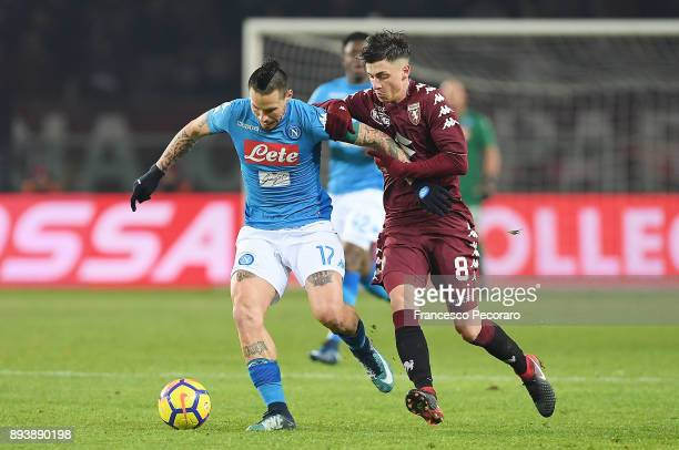 Player of SSC Napoli Marek Hamsik vies with Torino FC player Daniele Baselli during the Serie A match between Torino FC and SSC Napoli at Stadio...