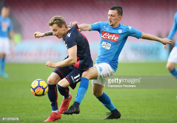 Player of SSC Napoli Mario Rui vies with Bologna FC player Ladislav Krejci during the serie A match between SSC Napoli and Bologna FC at Stadio San...