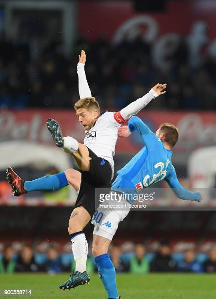 Player of SSC Napoli Marko Rog vies with Atalanta BC player Papu Gomez during the TIM Cup match between SSC Napoli and Atalanta BC on January 2 2018...