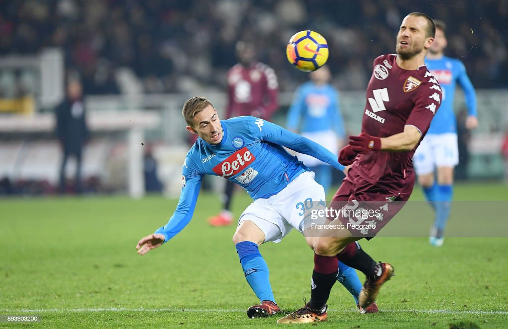 Player of SSC Napoli Marko Rog vies with Torino FC player Lorenzo De Silvestri during the Serie A match between Torino FC and SSC Napoli at Stadio Olimpico di Torino on December 16, 2017 in Turin, Italy.