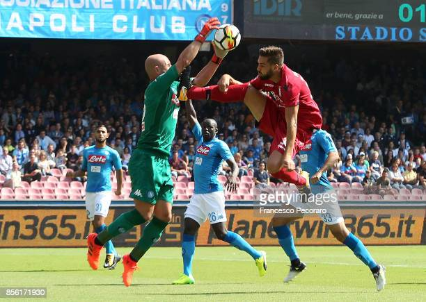 Player of SSC Napoli Pepe Reina vies with Cagliari Calcio player Leonardo Pavoletti during the Serie A match between SSC Napoli and Cagliari Calcio...