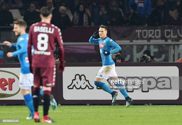 Player of SSC Napoli Piotr Zielinski celebrates after scoring the 02 goal beside the disappointment of Daniele Baselli player of Torino FC during the...