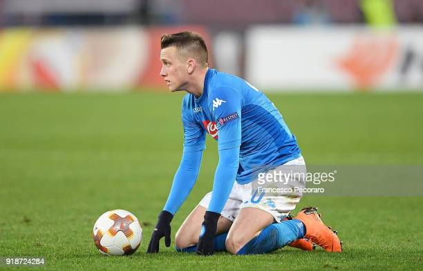 Player of SSC Napoli Piotr Zielinski stands disappointed during UEFA Europa League Round of 32 match between Napoli and RB Leipzig at the Stadio San...