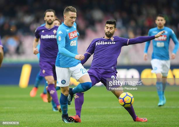 Player of SSC Napoli Piotr Zielinski vies with ACF Fiorentina player Marco Benassi during the Serie A match between SSC Napoli and ACF Fiorentina at...
