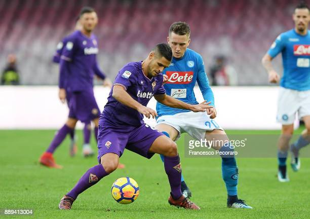 Player of SSC Napoli Piotr Zielinski vies with ACF Fiorentina player German Pezzella during the Serie A match between SSC Napoli and ACF Fiorentina...