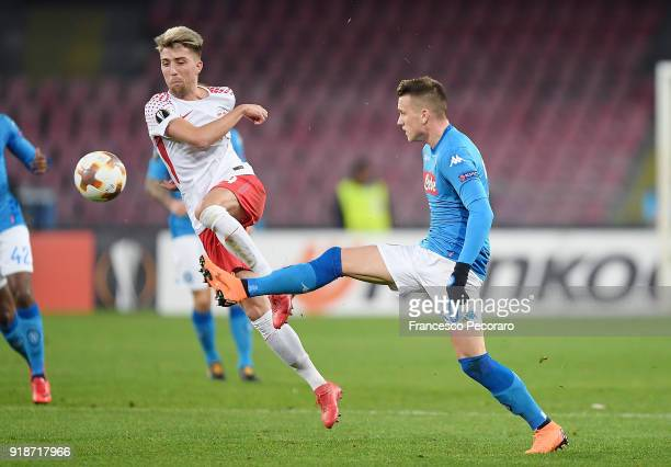 Player of SSC Napoli Piotr Zielinski vies with RB Leipzig player Kevin Kampl during UEFA Europa League Round of 32 match between Napoli and RB...