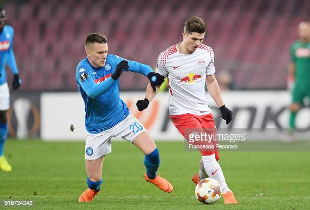 Player of SSC Napoli Piotr Zielinski vies with RB Leipzig player Marcel Sabitzer during UEFA Europa League Round of 32 match between Napoli and RB...