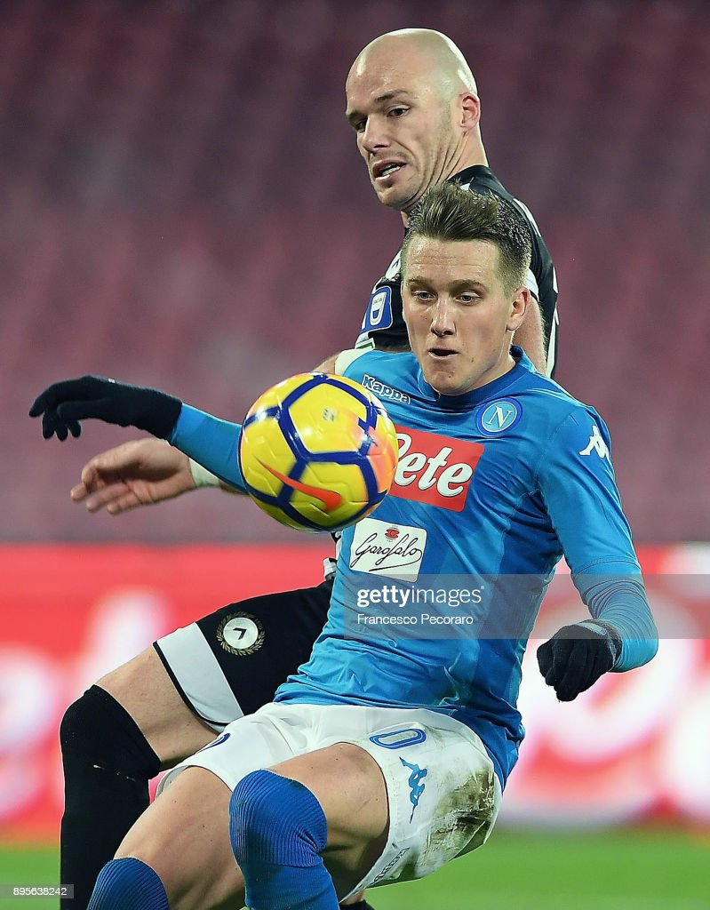 Player of SSC Napoli Piotr Zielinski vies with Udinese Calcio player Bram Nuytinck during the TIM Cup match between SSC Napoli and Udinese Calcio at Stadio San Paolo on December 19, 2017 in Naples, Italy.