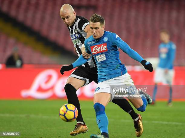 Player of SSC Napoli Piotr Zielinski vies with Udinese Calcio player Bram Nuytinck during the TIM Cup match between SSC Napoli and Udinese Calcio at...