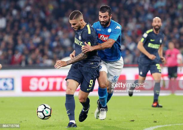 Player of SSC Napoli Raul Albiol vies with FC Internazionale player Mauro Icardi during the Serie A match between SSC Napoli and FC Internazionale at...