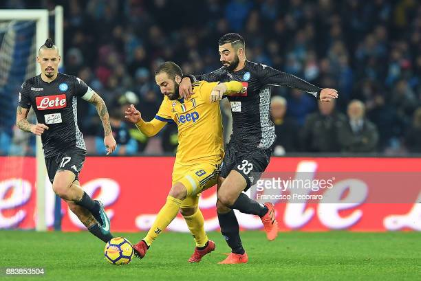 Player of SSC Napoli Raul Albiol vies with Juventus player Gonzalo Higuain during the Serie A match between SSC Napoli and Juventus at Stadio San...