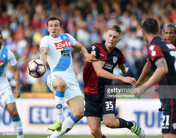 Player of SSC Napoli Vlad Chiriches vies with Cagliari Calcio player Bartosz Salamon during the Serie A match between SSC Napoli and Cagliari Calcio...