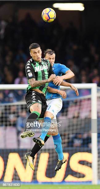Player of SSC Napoli Vlad Chiriches vies with US Sassuolo player Gianluca Scamacca during the Serie A match between SSC Napoli and US Sassuolo at...