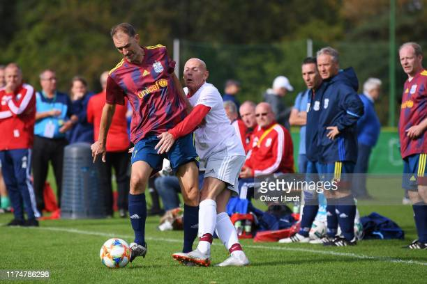 Player of SSV Koepenick Oberspree competes for the ball with Player of FC Bayern Muenchen on Day 2 of the DFB Over40 And Over50 Cup between SSV...