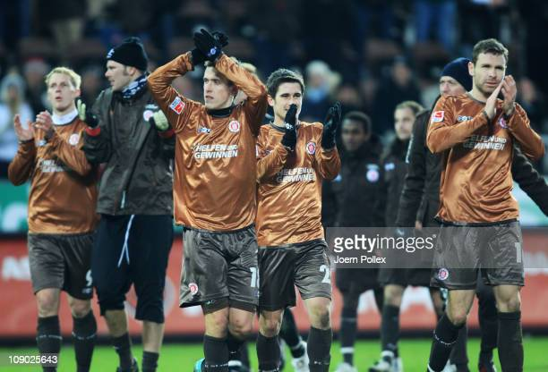 Player of St Pauli celebrate after winning the Bundesliga match between FC StPauli and Borussia Moenchengladbach at Millerntor Stadium on February 12...