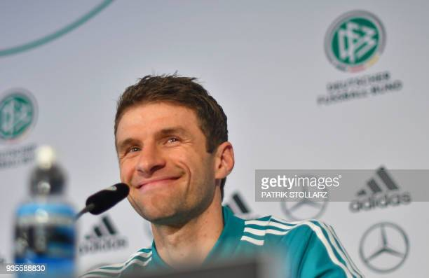 Player of the German national football team Thomas Mueller smiles as he attends a press conference ahead of the team's international friendly match...