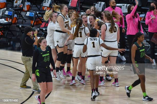 Player of the Iowa Hawkeyes celebrate after a college basketball game against the Michigan State Spartans in the semifinals of the Big Ten Conference...