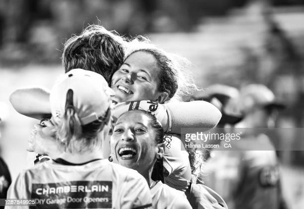Player of the match Hannah Darlington of Thunder celebrates with team during the Women's Big Bash League WBBL Semi Final match between the Brisbane...