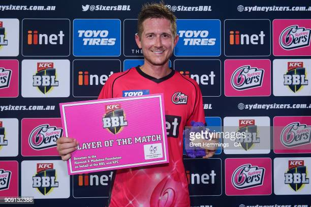 Player of the match Joe Denly of the Sixers poses for a photo during the Big Bash League match between the Sydney Sixers and the Melbourne Stars at...