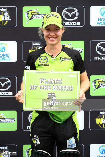 Player of the match Nicola Carey of the Thunder poses for a photo after the Women's Big Bash League match between the Sydney Thunder and the...