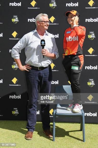 Player of the match, Nicole Bolton of the Scorchers stands on a chair to be interviewed by Tim Gossage of Channel 10 after the Women's Big Bash...