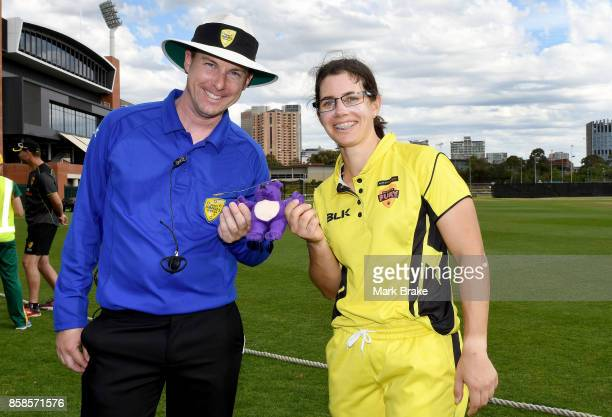 Player of the match Nicole Bolton receives the teddy bear award from umpire Luke Uthenwoldt during the WNCL match between Tasmania and Western...