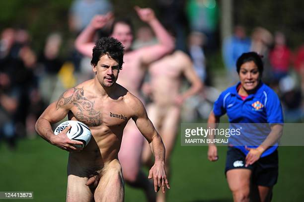 A player of The Nude Blacks of New Zealand runs to score a try despiste players of Spanish Conquistadores a female team from Barcelona in Dunedin on...