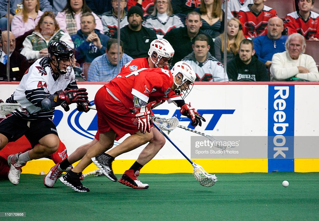 Player of the Philadelphia Wings chases after a ground ball behind players of the Boston Blazers on January 8, 2011 in Philadelphia, Pennsylvania. The Boston Blazers defeated the Philadelphia Wings 10-6.