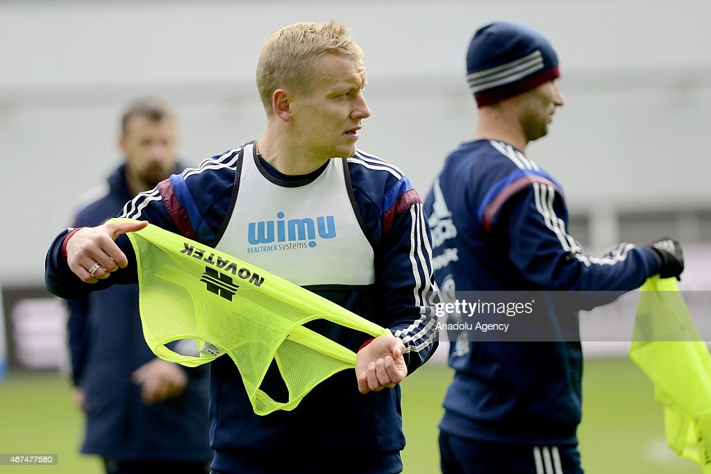 Player of the Russia national soccer team Igor Smolnikov (L) seen during training session of Russian national soccer team at Arena Khimki in Russia, Moscow before UEFA Euro 2016 qualifying Group G soccer match against Montenegro national soccer team.