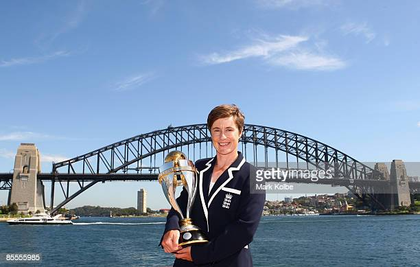 Player of the tournament Claire Taylor of England poses with the ICC Women's World Cup 2009 trophy at the Opera House overlooking Sydney Harbour on...