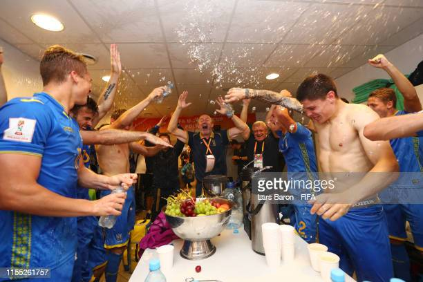 Player of Ukraine celebrate inside the dressing room following their sides victory in the 2019 FIFA U20 World Cup Semi Final match between Ukraine...