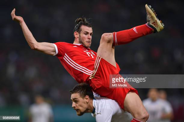 A player of Uruguay national football team challenges Gareth Bale top of Wales national football team in their final match during the 2018 Gree China...