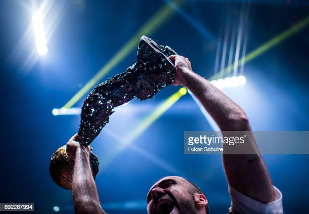 A player of Vardar holds the trophy after winning the VELUX EHF FINAL4 Final match between Paris SaintGermain Handball and HC Vardar at Lanxess Arena...
