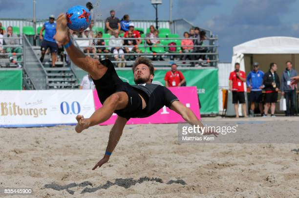 A player of Wuppertaler SV plays the ball on day 1 of the 2017 German Beach Soccer Championship on August 19 2017 in Warnemunde Germany