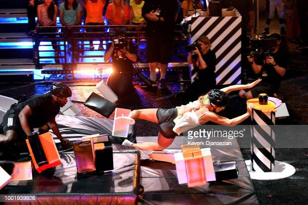NHL player P K Subban and skier Mikaela Shiffrin participate in a challenge onstage during the Nickelodeon Kids' Choice Sports 2018 at Barker Hangar...
