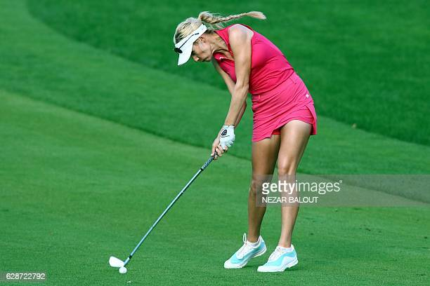 US player Paige Spiranac plays a shot during the third round of the Dubai Ladies Masters at the Emirates Golf Club on December 9 in Dubai / AFP /...